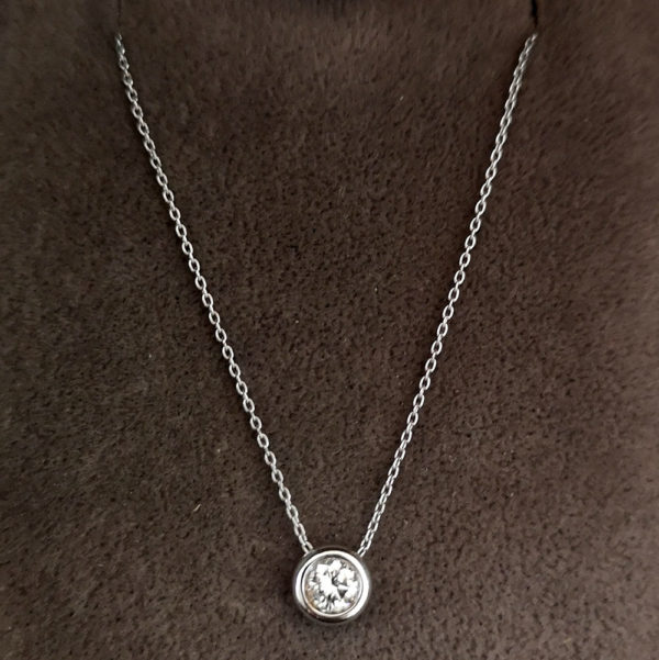 0.15 Carat Diamond Rub-over Pendant & Chain