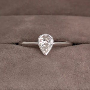0.46 Carat Diamond Pear Shaped Rub-Over Engagement Ring