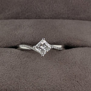 0.50 Princess Cut Diamond Twist Ring with Fancy Grain Set Diamond Shoulders