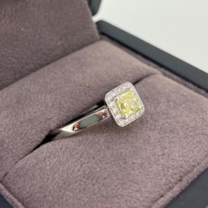 0.55 Carat Yellow Diamond Halo Engagement Ring