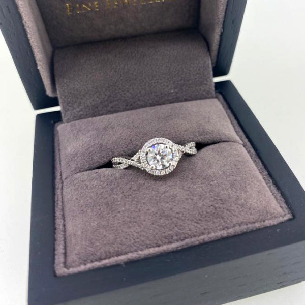 0.64 Carat Round Brilliant Cut Diamond Ring with Halo & Twist Shoulders