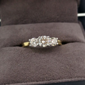 0.88 Carat Round Brilliant Cut Three Stone Diamond Ring