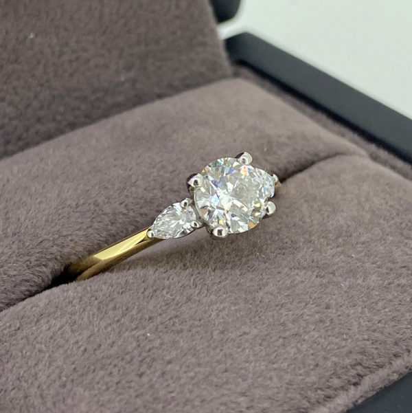0.91 Carat Round Brilliant Cut Ring with Pear Shaped Shoulders