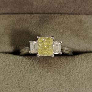 1.42 Carat Fancy Yellow Diamond Cushion Cut Three Stone Ring