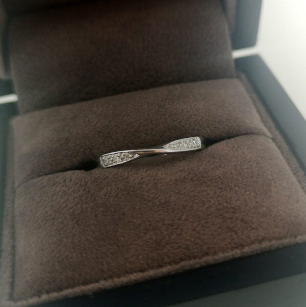 0.06 Carat Twist Grain Set Diamond Band