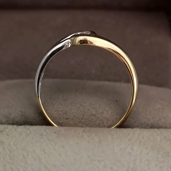 0.10 Round Brilliant Cut Diamond Twist Ring in White & Yellow Gold