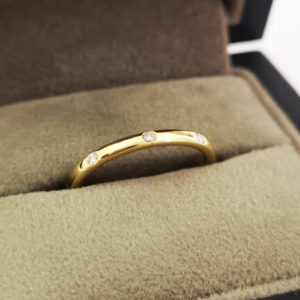 0.14 Carat Yellow Gold Diamond Dot Wedding Band